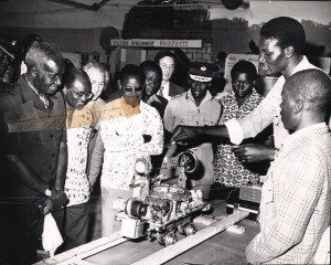 President Kaunda, Prime Minister Mr. Daniel Lisulo, and Education Minister Lameck Goma looking at an automatic electric rail made by Mr. Elias Zimba of Chizongwe Secondary School during the Jets exhibition held at Lusaka's Showground, 16 Aug 1978